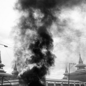 Burning tyre next to Jamia Masjid Mosque during a protest.