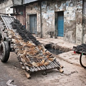 Scraps of animal dries on a cart.
