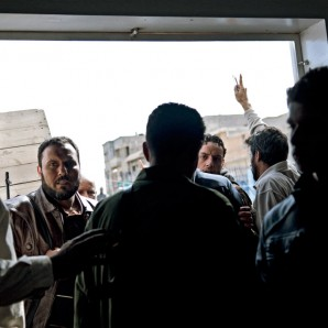 People gather at the morgue in Benghazi to identify their relatives among the victims.