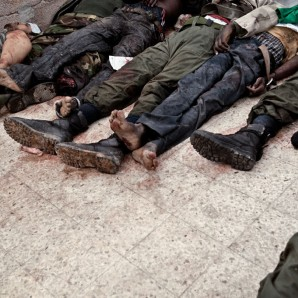 Dead bodies of Libyan loyalists lie in a room at the morgue. Among them, mercenaries from other African countries.