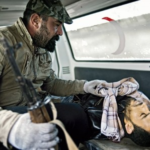 An ambulance carries a dead rebel to the morgue in Benghazi.