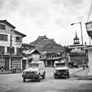 Police patrol the street of Srinagar.