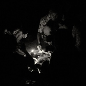 Laborers have dinner. Candle light is the only surce of light at the plantation.