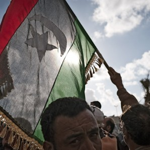 A Libyan independence flag is waved after Gaddafi forces withdrew from Benghazi.